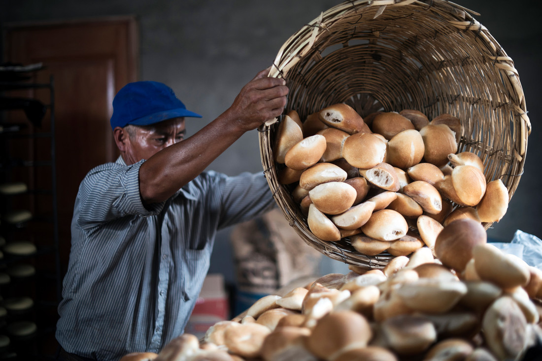 """""""Can you smell the bread? Sometimes I taste one and I can believe I'm the one who has made it!"""".Hector Demetrio is 57 years old and has worked his entire life as a farmer in Peru. Credit: Ana Caroline de Lima/ CARE."""