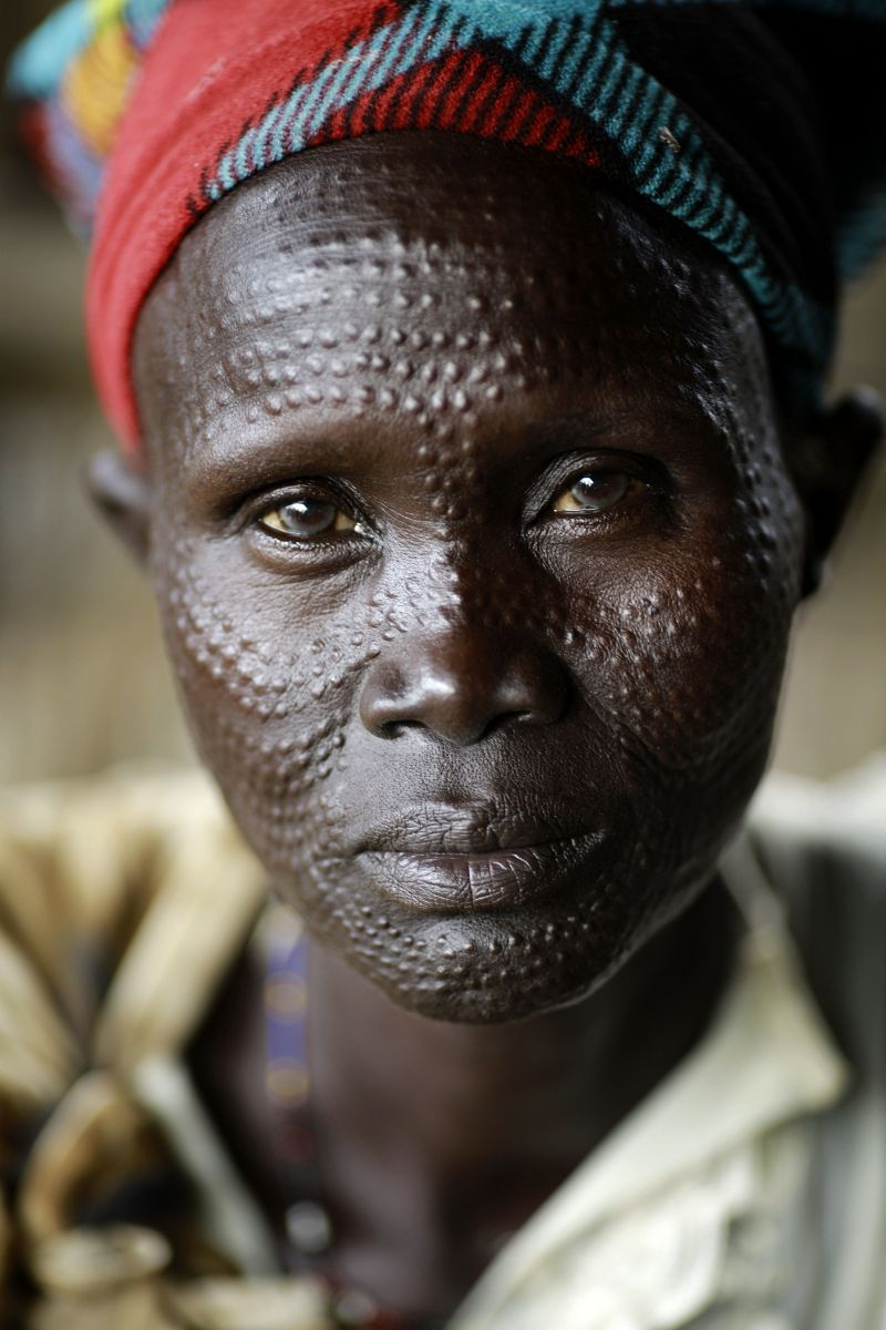 "Nyanjan Gew, 50, walked two hours to Mankien, Unity State, South Sudan to buy soap. She will stay for two days with relatives in Mankien. .A bar of soap that used to cost 12ssp now cost 20ssp.""Prices have risen so much that you can't buy a mosquito net unless you sell a cow."" (Photo by Josh Estey/CARE)"