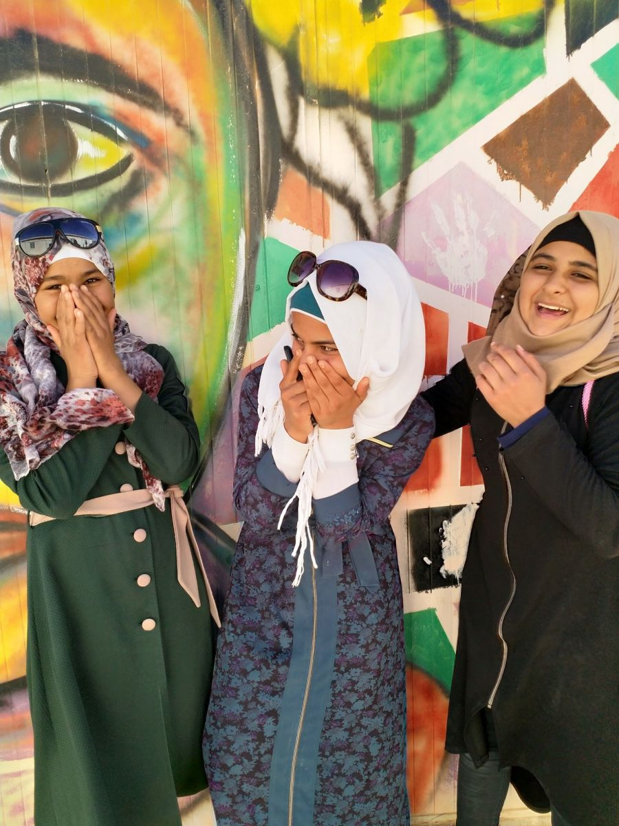 Fatima, Abir, and Ghaida all participated in the Azraq Film School, through which 25 participants helped create short, documentary style films presenting stories of fellow refugees at the Azraq Camp in Jordan. Credit: Emily Milton / CARE.