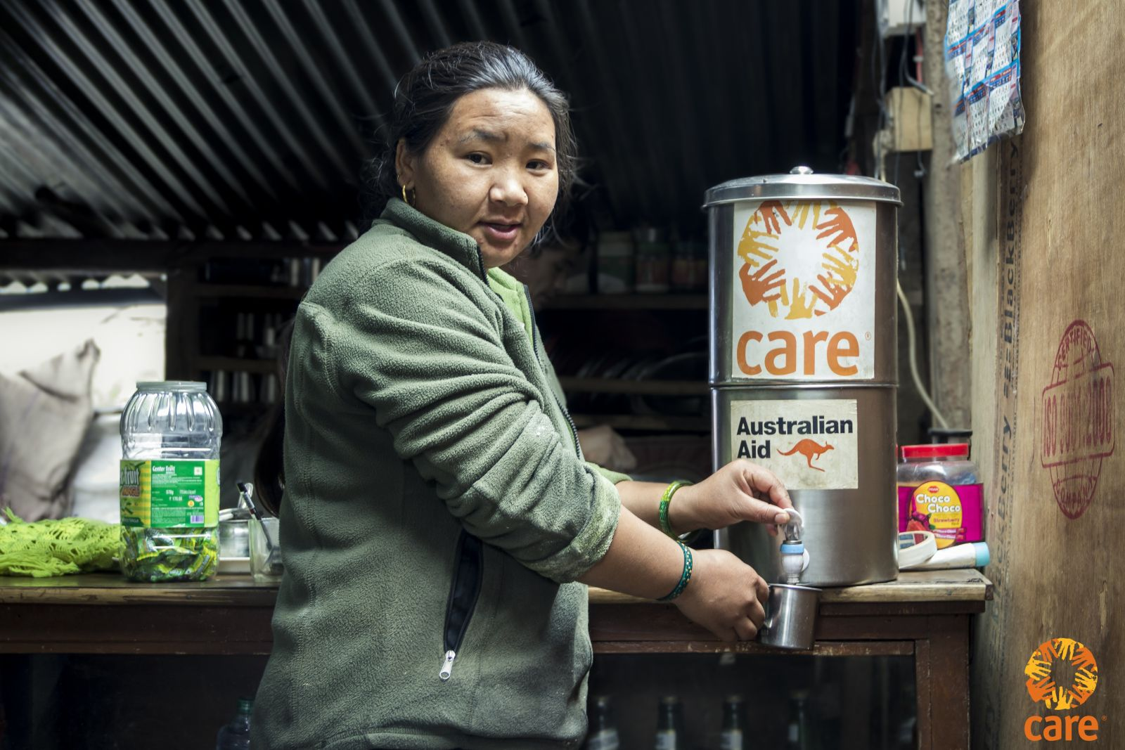 "Sunita Gurung along with her husband ram Krishna Gurung runs a hotel in their village. Their shop is specially famous for momos (Meat dumpling) ""We can serve clean water to our customers without worrying about the health hazards of my customers"" . Photo: Grishma Aryal/CARE."