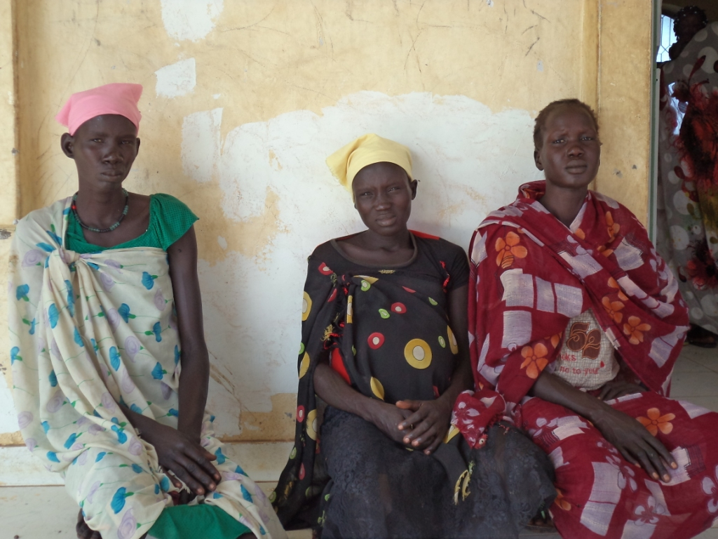 Women sit outside a CARE-supported health facility in Unity State, South Sudan. Photo: Robinah Baseka/CARE.
