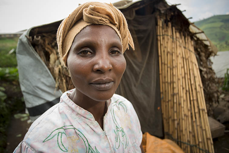 Mrs. Sifa Thérèse is a woman displaced by conflict in the DRC living in Kibabi Camp, Masisi Territory, North Kivu Province. Her husband was killed in their home village before their family fled to the safety of the camp. Her family has received food aid and plastic sheeting from CARE.CARE/Jake Lyell