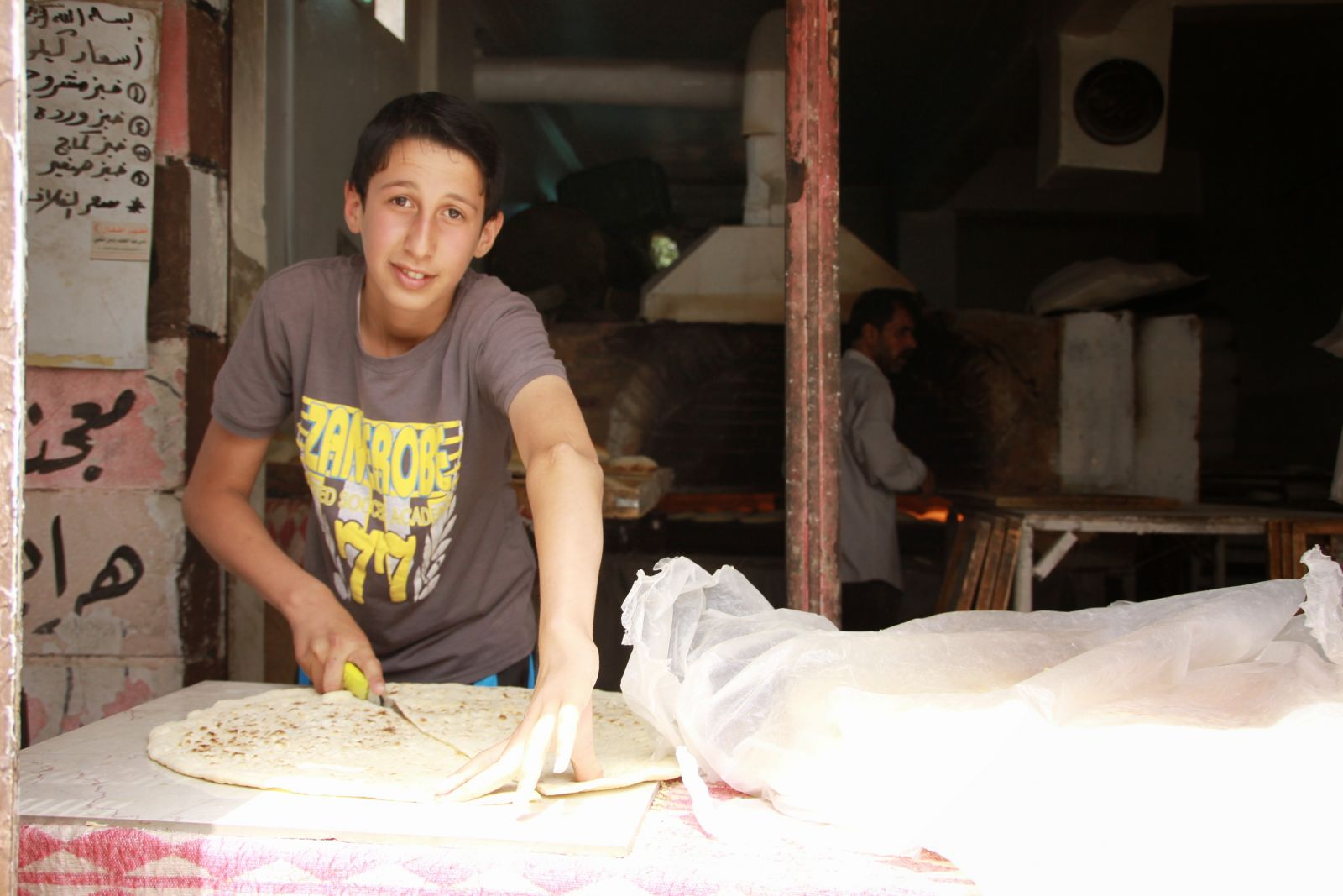 Hamdan, 14, works every day from 7 am to 10 pm. In between he goes to school. His family fled from Homs 2 years ago. Photo: Mitscherlich/CARE