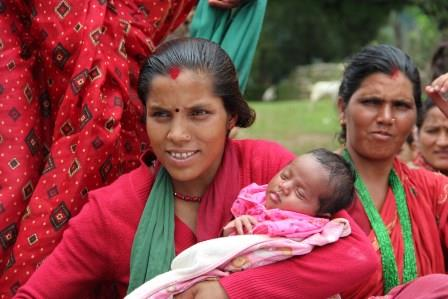 This woman and her baby participate in a Mothers Group in Nepal to look after her own and other womens health.