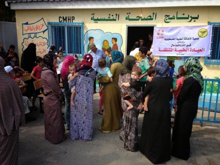Women waiting in front of CARE mobile health clinic in Gaza. CARE calls for stronger participation of women in peace and recovery process.
